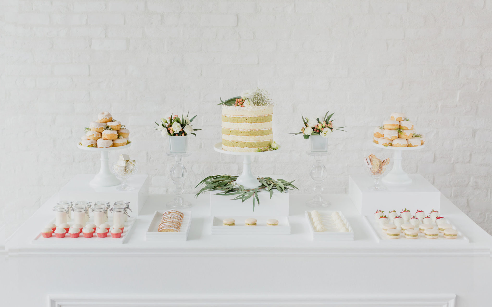 A table with desserts from an event catered by Ristorante Beatrice.