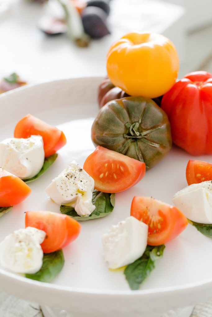 A tomato and mozzarella hors d'oeuvre from an event catered by Ristorante Beatrice.