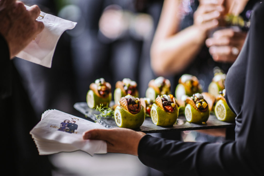 Hors d'oeuvres being served at an event catered by Ristorante Beatrice.