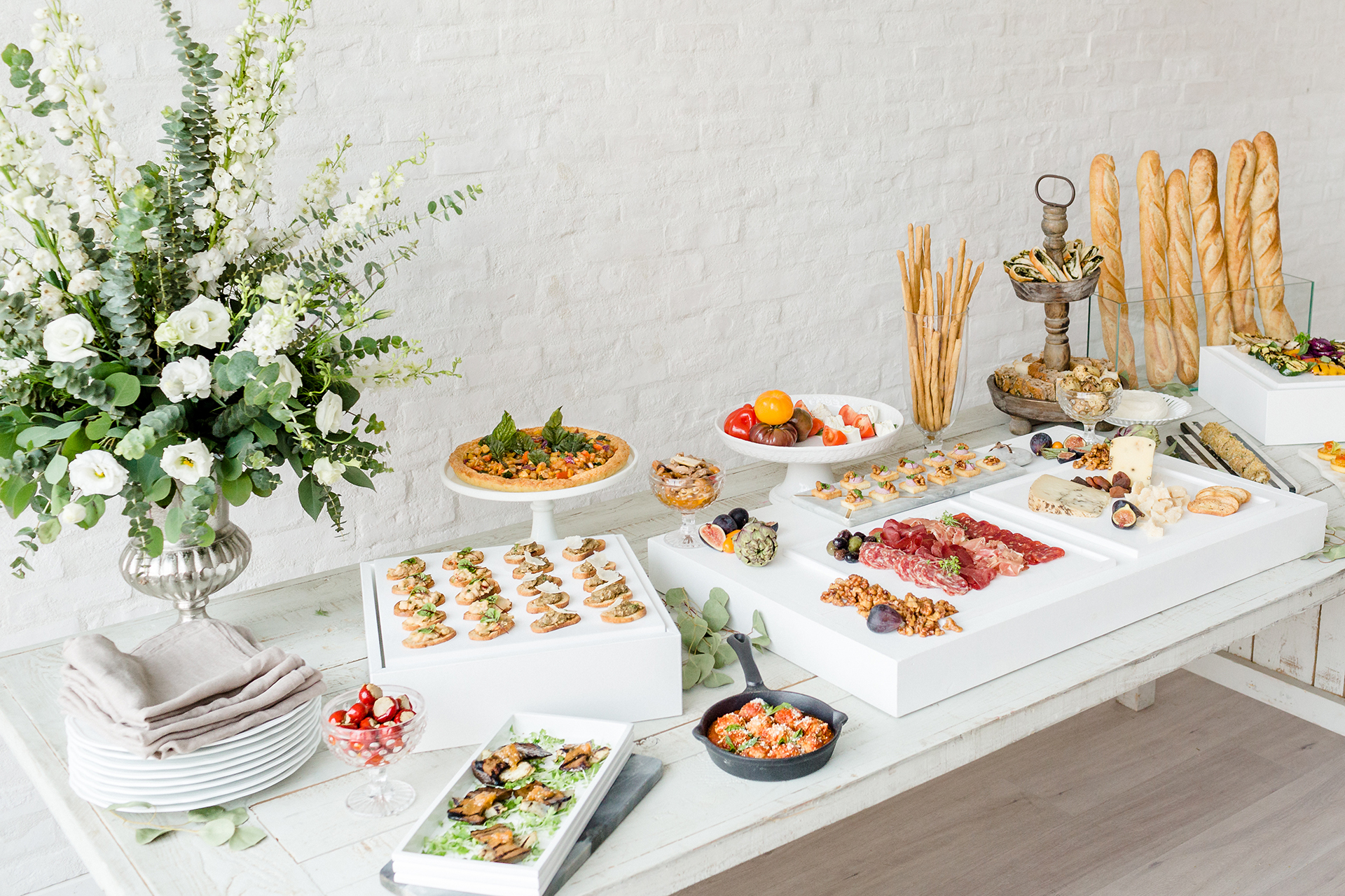 A table with food from an event catered by Ristorante Beatrice.